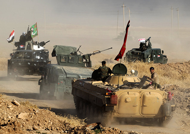 Iraqi forces deploy in the area of al-Shourah, some 45 kms south of Mosul, as they advance towards the city to retake it from the Islamic State (IS) group jihadists, on October 17, 2016
