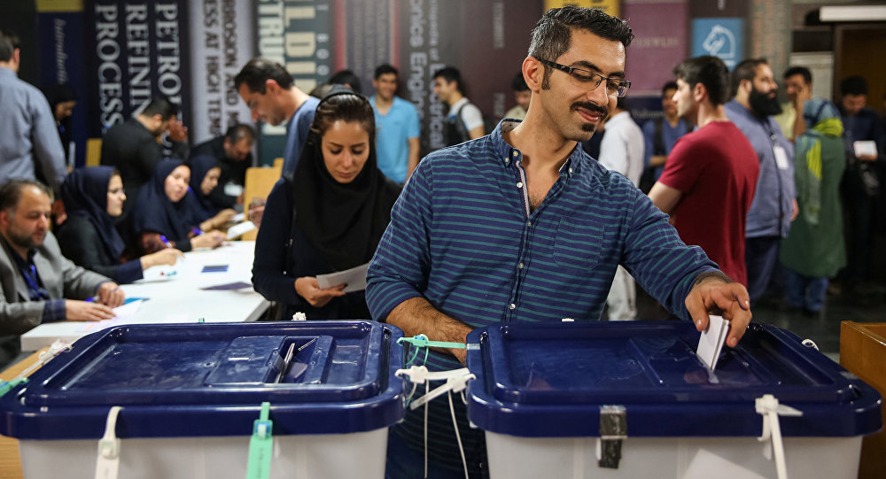 Iranians cast their votes during the presidential election in a polling station in Tehran, Iran, May 19, 2017